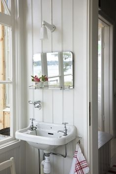White wood, sink and mirror