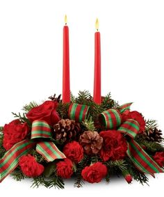 What a glorious addition to any holiday table. This centerpiece is full of red roses and carnations, pinecones, and mixed Christmas greenery. The holiday ribbon and two red taper candles add a warming touch. Everyone at your Christmas table will enjoy it! Centerpiece Christmas, Christmas Arrangements, Holiday Centerpieces, Candle Centerpieces, Holiday Tables, Flower Arrangements, Christmas Decorations, Candle Decorations, Centrepieces