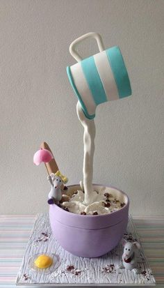 One of my first gravity defying cakes :) All of it is cake, including the milk jug! Made in a class with Sharon Wee