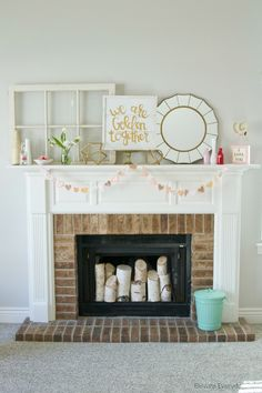 Love this sweet mantle - and that mirror is darling!
