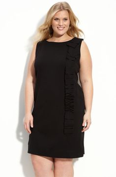 love the cut and ruffle in this little black dress