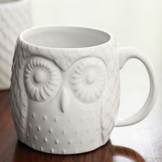 owl mugs in different colors.