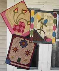 """Holiday Treasures Wallhanging. Each Project 16 x 20"""". Celebrate the spring and summer holidays with these charming wall hangings. These projects are made using mostly fat quarters and fat eighths. Easy appliqué and embroidery accents. http://www.kayewood.com/Holiday-Treasures-Set-of-3-Wallhanging-Patterns-by-Snuggles-Quil-SQ-HOTR.htm  $8.00"""