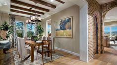 Exposed beams and brick accents