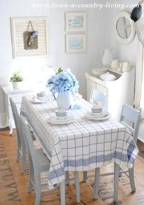 Farmhouse Dining Room dressed for spring in blue and white.