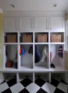 No space for this glorious mudroom? Steal the ideas - a storage shelf, a row of pegs and a seat/bench with space underneath for boots. Black & white sheet vinyl or stick on tiles will give you years of practical wear - it doesn't have to be marble!