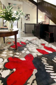 Snowdrop - Rug Collections - Designer Rugs - Premium Handmade rugs by Australia's leading rug company  This stunning design makes for an interesting entry, It makes a bold statement with the bright patches of red.  With this type of design the remaining decor is better off being simple, allowing this piece of floor art do all the talking.