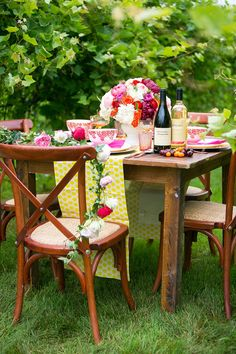 a vibrant table scape, perfect for a summer wedding #table #decor #pink http://www.weddingchicks.com/2013/12/27/fanciful-floral-wedding-ideas/