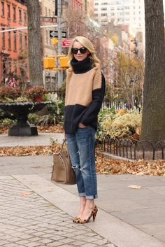 Great sweater. Color blocking at its best. And I love the look of cropped jeans with leopard heels. Oh so chic!