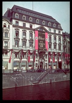 Banners hang from buildings with alpine bushings with a personalized happy birthday, all in gold. This was in honor of Adolf Hitler's 50th birthday, Berlin, German Reich, April 20, 1939