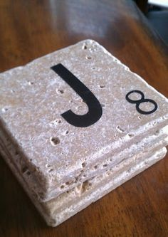 Scrabble coasters.  These would be an awesome gift for the word loving friend.