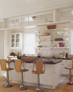 Love these barstools in this crisp white kitchen