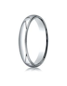 This beautiful Platinum 4mm band features a slightly domed surface with milgrain edges and Comfort-Fit on the inside for unforgettable comfort.  Made in the United States. Ships within 2-3 business da...