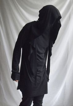 the hood has sharp end attached around the back of the neckline -a long mask like neck going as high as the forehead -the edges are intentionally