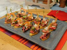 Surf and Turf Rib-Eye Crostini with Gorgonzola Mousse and Caramelized Bourbon Shallots recipe from Jeff Mauro via Food Network