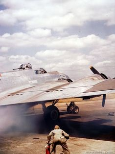 A crew chief watches closely for signs of fire as Boeing B-17 is started at a base in England.