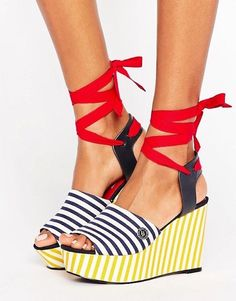 Rock National Stripes Day with these Tommy Hilfiger x Gigi Hadid stripe wedge sandals that are absolutely to die for.