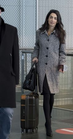 Amal Clooney bundles up as she gets ready to fly out of Euro Airport Basel-Mulhouse-Freiburg on Wednesday (January in Saint-Louis, France. She wore a grey tweed coat with her Paule Ka bow pumps. The bag is by Dior. Amal Clooney, George Clooney, Business Outfits, Office Outfits, Winter Typ, Tweed Coat, Office Fashion, Lawyer Fashion, In Pantyhose