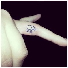 08 Small Elephant Tattoo on finger