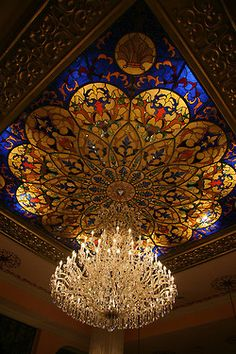 "visitheworld: "" Chandelier in the lobby at Riu Palace, Riviera Maya, Mexico (by JohnRiv). Mosaic Glass, Glass Art, Palace Interior, Architectural Elements, Beautiful Buildings, Chandelier Lighting, Crystal Chandeliers, Beautiful Lights, Stained Glass Windows"