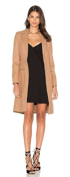 Donatella short winter coat by Lioness. Self: 65% poly 35% woolLining: 100% poly. Dry clean only. Button front closures. Front welt pockets. Buttoned sleeves...