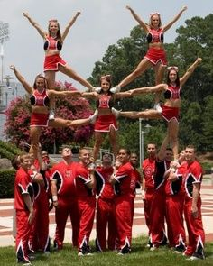 Cheer stunt. It´s not easy to get the balance right. I love watching cheer stunts.