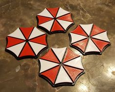 Resident Evil Inspired Umbrella Corporation Coasters- Set of 4 - $20.99+ Bring a little bit of the apocalypse home. Perfect any Resident Evil fan.