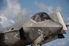 Navy pilot taxis in an F-35C Lightning II carrier variant, on the flight deck of…