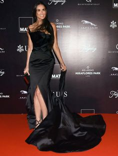 Demi Moore Wows in a Revealing High-Slit Black Gown at Peruvian Charity Gala from InStyle.com