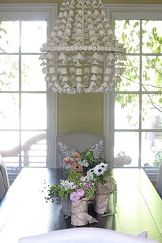 {love the display of these flowers on the table... paper bag and jute!}