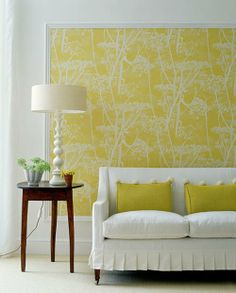 """""""Frame"""" wallpaper with moulding to help fill an otherwise blank wall. Could be just the thing for that empty space in the living room ..."""