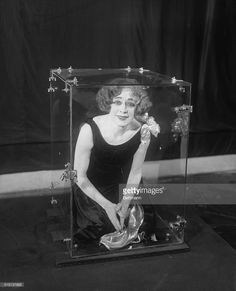 Beatrice Houdini, wife of Harry Houdini, locked in a plate glass box from which she escapes to illustrate the secret dimensional principal employed by her late husband. Get premium, high resolution news photos at Getty Images Stock Pictures, Old Pictures, Stock Photos, Magic Illusions, Creative Video, Video Image, Weird World, Historian, Stunts