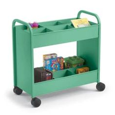 Oooh...these book carts look way better than the Land of Nod versions I was eyeing AND come in a million colors and different storage shelf options.  Pricey but look durable and Iike that they could pull right over to the table.