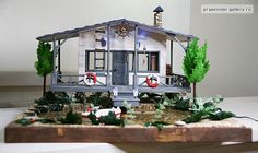 the wooden dollhouse at the pond by miniwood, via Flickr