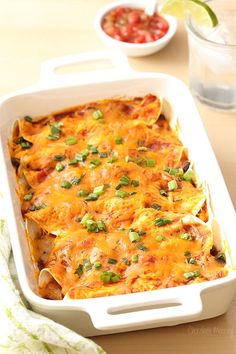 No need to run out to a Mexican restaurant when you can make these easy Salsa Chicken Enchiladas at home! Recipe for a homemade enchilada sauce also included.