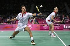 Britain's Chris Adcock, left, and Imogen Bankier play against Russia's Valeria Sorokina and Alexandr Nikolaenko, unseen, at a mixed doubles badminton match of the 2012 Summer Olympics, Saturday, July 28, 2012, in London.