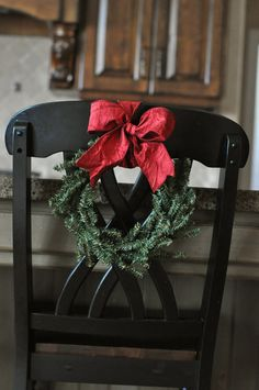 Wreaths on dining room table chairs