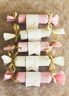 DIY candy poppers - we can make these for table favors at each place setting and they can be made out of crepe paper and ribbon - very inexpensive and we could put a rose on the banner.
