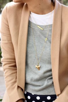 Very cute layering of necklaces. Everything else may be a little preppy though.
