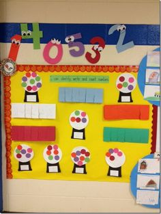 Identify, write and count numbers. What a cute math bulletin board idea with gumballs. http://hative.com/creative-math-bulletin-board-ideas/