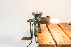 INDUSTRIAL MEAT GRINDER LAMP. Industrial lighting made from a vintage meat grinder by TAATMAAKT on Etsy