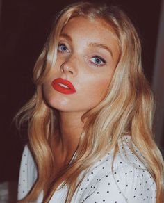 Natural makeup with a bold red lip