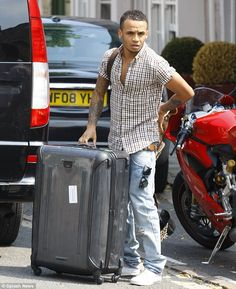 Aston Merrygold from UK band JLS with his Tumi Vapor case on the morning of Marvin and Rochelle's Wedding