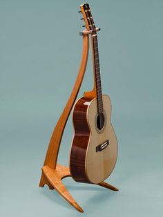 Take a Stand Guitar Stands Wooden Guitar Stand, Guitar Storage, Diy Table Legs, Violin Sheet Music, Guitar Hanger, Cool Electric Guitars, Music Stand, Learn To Play Guitar, Fine Furniture