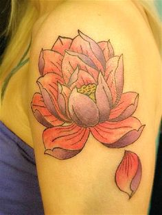 A fully blossomed pink lotus flower tattoo. The lotus flower is also shown to have its petals falling apart in a simple dramatic drop.