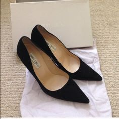 Jimmy Choo black suede heels Worn only 2-3 times. These are in great shape. A few minor scuffs as seen on picture but not at all noticeable. These are very elegant and stylish. These are a great pair of shoes to go with many outfits in any wardrobe. Includes box and dust bag. Jimmy Choo Shoes Heels