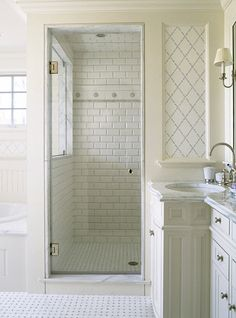 White bathroom with subway tile walk in shower