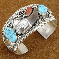 Native American Zuni Handcrafted Bracelets Native American Genuine Sleeping Beauty Turquoise Coral Bear Claw Sterling Silver Bracelet. A stunning work of hand made jewelry. This bracelet is full of natural character with gorgeous nuggets of genuine Sleeping Beauty Turquoise and Coral surrounding a genuine Bear Claw http://nativeamericanstuff.net/WholeSale%20Native%20American%20Bracelets.htm