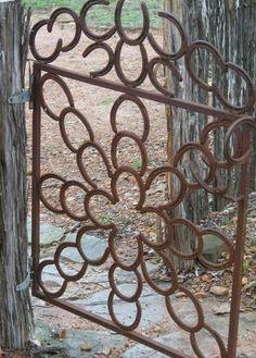 Super cute gate using old horse shoes.