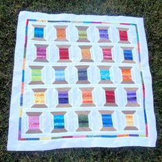 The Rainbow Shuffle Spool Quilt is the exact scrap quilt you've been looking for! This fun, colorful quilt takes the classic, vintage spool quilt pattern and turns it into something fresh.